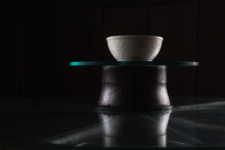 Bowl on stand on table